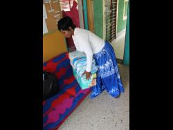 Pamputtae delivers items for wards at Mustard Seed Children's Home on Mahoe Drive, St Andrew on Wednesday..