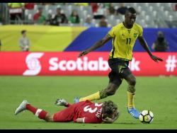 Canada's Michael Petrasso is taken down by Jamaica's Cory Burke during a Concacaf Gold Cup quarter-final match on Thursday, July 20, 2017.