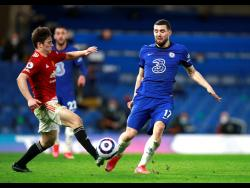 Chelsea's Mateo Kovacic, right, and Manchester United's Victor Lindelof challenge for the ball during the English Premier League match between Chelsea and Manchester United at Stamford Bridge Stadium in London, yesterday.