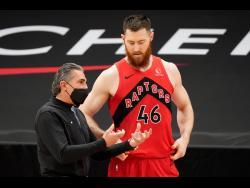 Toronto Raptors assistant coach Sergio Scariolo talks to centre Aron Baynes (46) during the first half of an NBA basketball game against the Houston Rockets Friday, February 26, 2021.