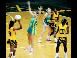 File photo shows Jamaica and Australia's Under-21 netball teams in a  match at the National Arena on November 23, 2012. Former Sunshine Girls assistant coach, Winston Nevers, is proposing that the national Under-21 team should have been drafted as replacement for South Africa in the Tri-nation series that also involves Trinidad & Tobago.