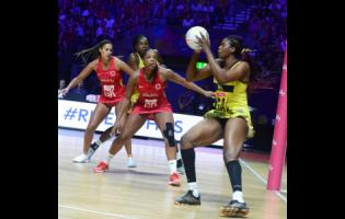 Romelda Aiken (right) gets the ball ahead of England's Eboni Usoro-Brown (centre) and Geva Mentor during a Vitality Netball World Cup match at the M&S Bank Arena in Liverpool, England last July.