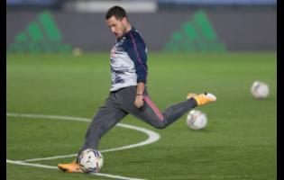 Real Madrid's Eden Hazard kicks the ball during the warm up prior of the Spanish La Liga match against  Alaves at Alfredo di Stefano stadium in Madrid, Spain,on  Saturday, November 28.