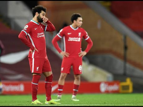 Liverpool's Mohamed Salah (left) looks on following the English Premier League match between Liverpool and Burnley in Liverpool, yesterday.